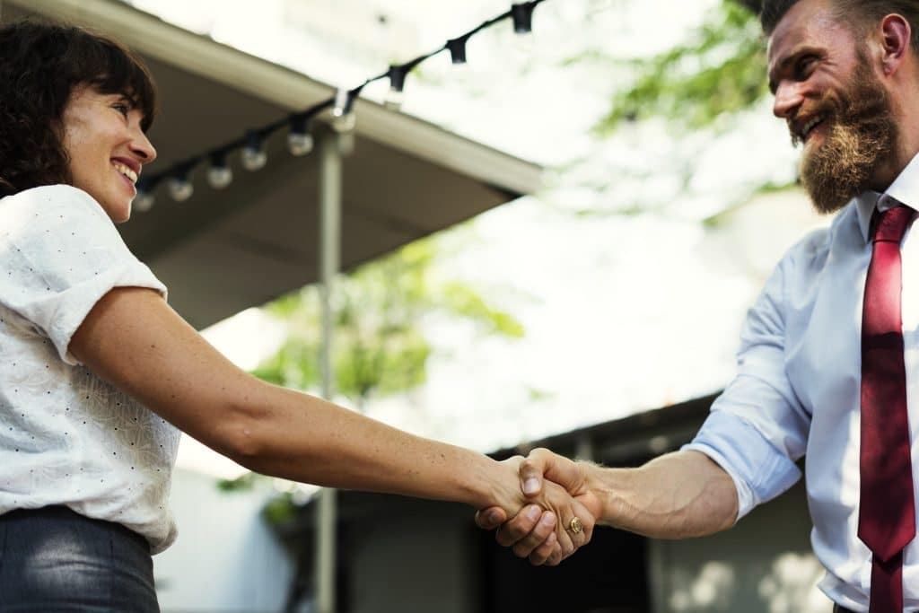 Man and women shake hands in agreement