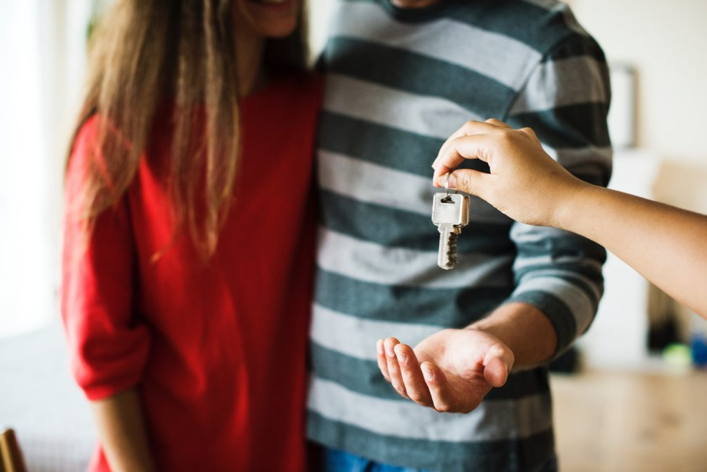 A couple is getting the keys of their new house